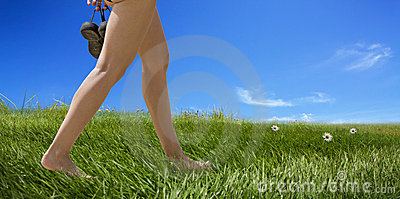 Female bare feet walking