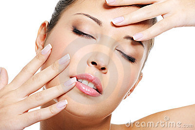 Female  with  beautiful fingernails near face