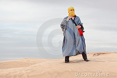 Female in bedouin clothes on dune