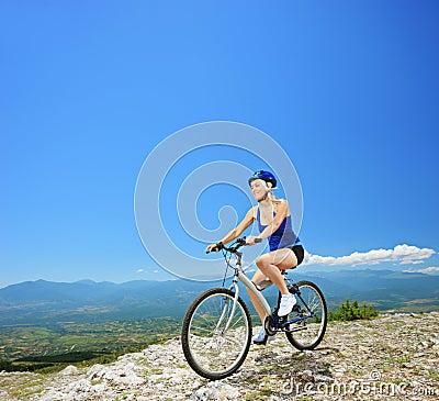 A female biker biking a mountain bike