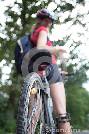 Female biker  on her mountain bike