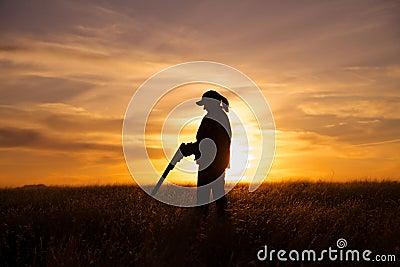 Female Bird Hunter in Sunset