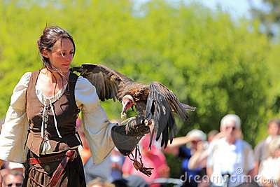 Female bird tamer Editorial Stock Image