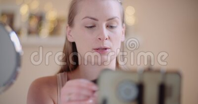 Female Blogger Makeup Artist Teching doing Makeup on line. Close up stock video