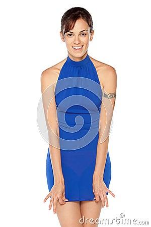 Female in blue dress posing
