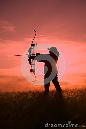 Female Bowhunter in Sunset