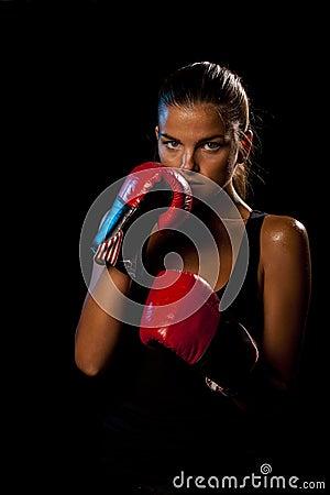 Female boxer on black background