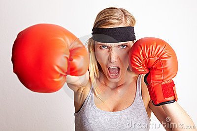 Female boxer hitting and screaming