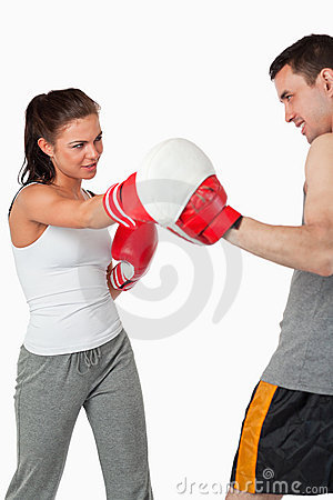 Female boxer listening to her instructor