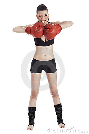 Female boxer looking very focused with red gloves
