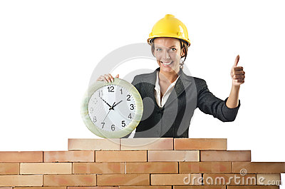 Female builder and clock