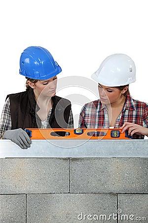 Female builder with spirit-level