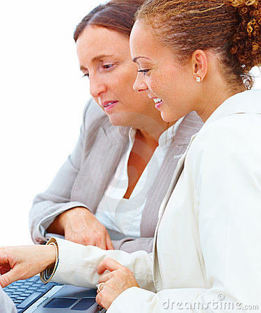 Female business colleagues using a laptop together