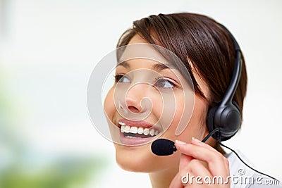 Female call centre employee speaking on headset