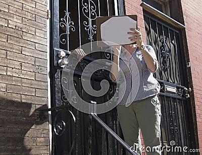 Female canvassing inner city neighborhood