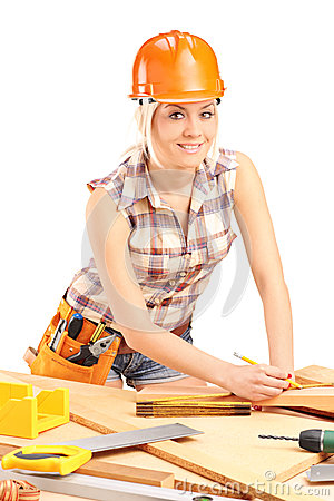 Female carpenter with helmet at work