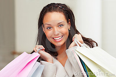 Female carrying shopping bags