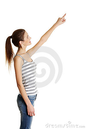 Female caucasian teen pointing up with a finger.