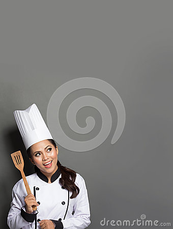 Free Female Chef Cooking Thinking What To Cook Royalty Free Stock Images - 47556749