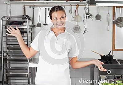 Female Chef Gesturing In Kitchen