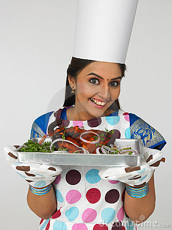 female chef with her roasted chicken