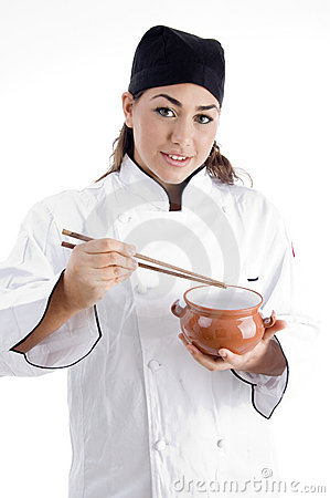 Female chef posing with chopstick and bowl