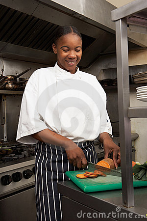 Female Chef Preparing Vegetables