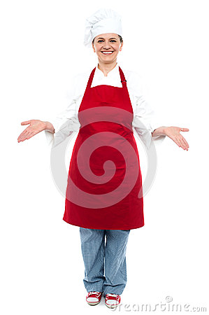 Female chef welcoming you with a smile