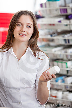 Female Chemist Holding Medication Container