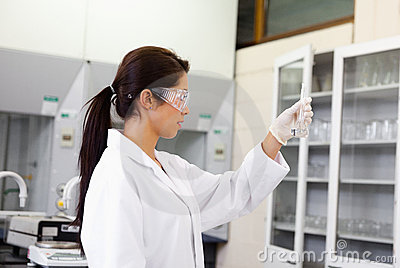 Female chemist looking at an Erlenmeyer flask