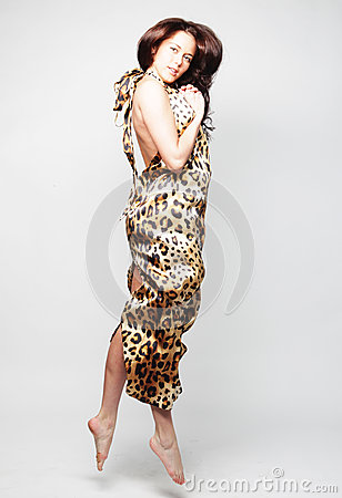Female in chiffon dress jumping