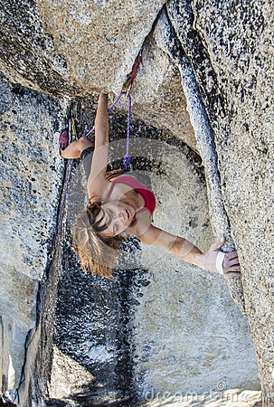 Female climber on the edge.