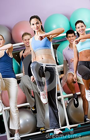 Free Female Coach Does Exercises With Her Group Stock Images - 26548084