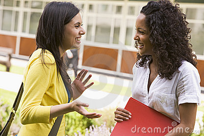 Female college friends talking on campus