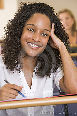 Free Female College Student Listening To A Lecture Royalty Free Stock Image - 5949206