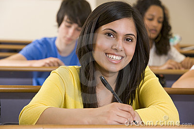 Female college student listening to a lecture