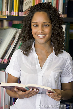 Free Female College Student Reading In A Library Stock Photos - 5949583