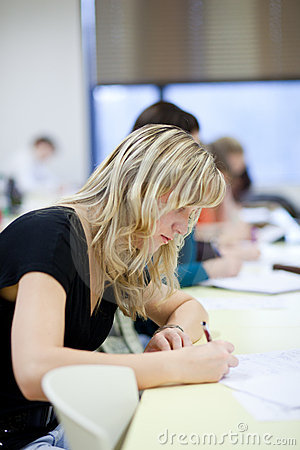 Female college student sitting in a classroom