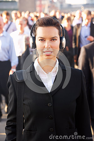 Female commuter in crowd