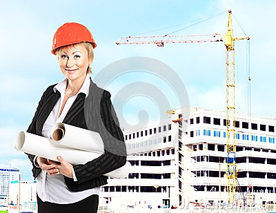 Female construction specialist reviewing
