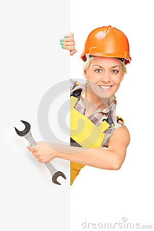 Female construction worker behind panel