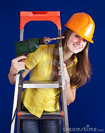 Female construction worker with drill