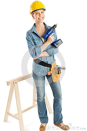 Female Construction Worker With Drill Standing By Work Horse