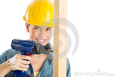 Female Construction Worker Drilling Wooden Plank