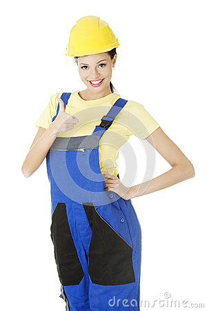 Female construction worker gesturing thumbs up