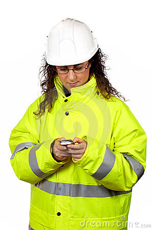 Female construction worker send a SMS