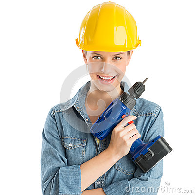 Female Construction Worker Wearing Helmet While Holding Drill