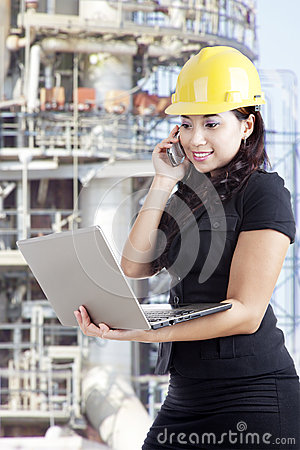 Female contractor working at industrial site
