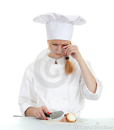 Female cook cutting onion