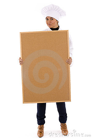 Female cook keeping cork board